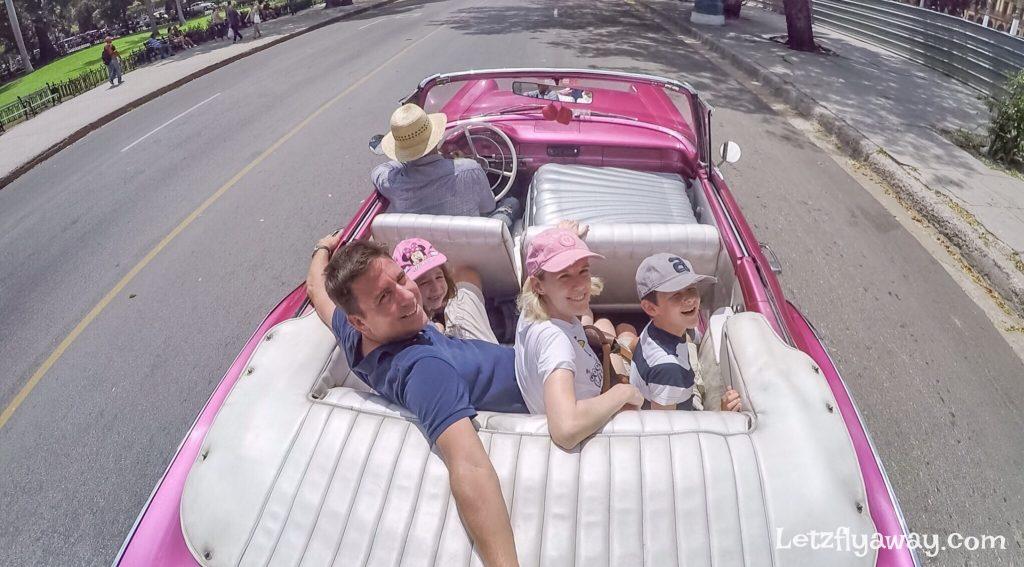american vintage car ride in havana with kids