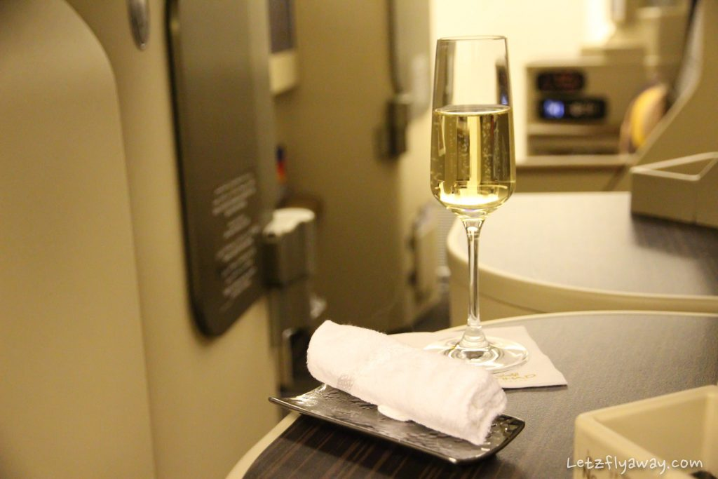 Etihad Business Class Boeing 777 champagne and cold towel