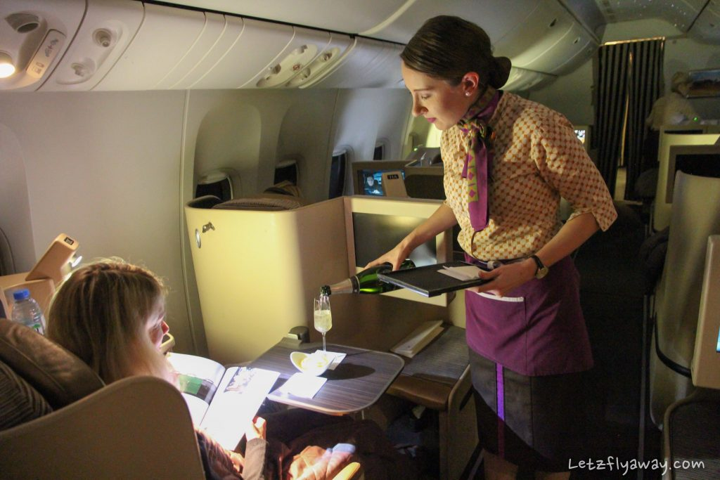 etihad business class boing 777 champagne service