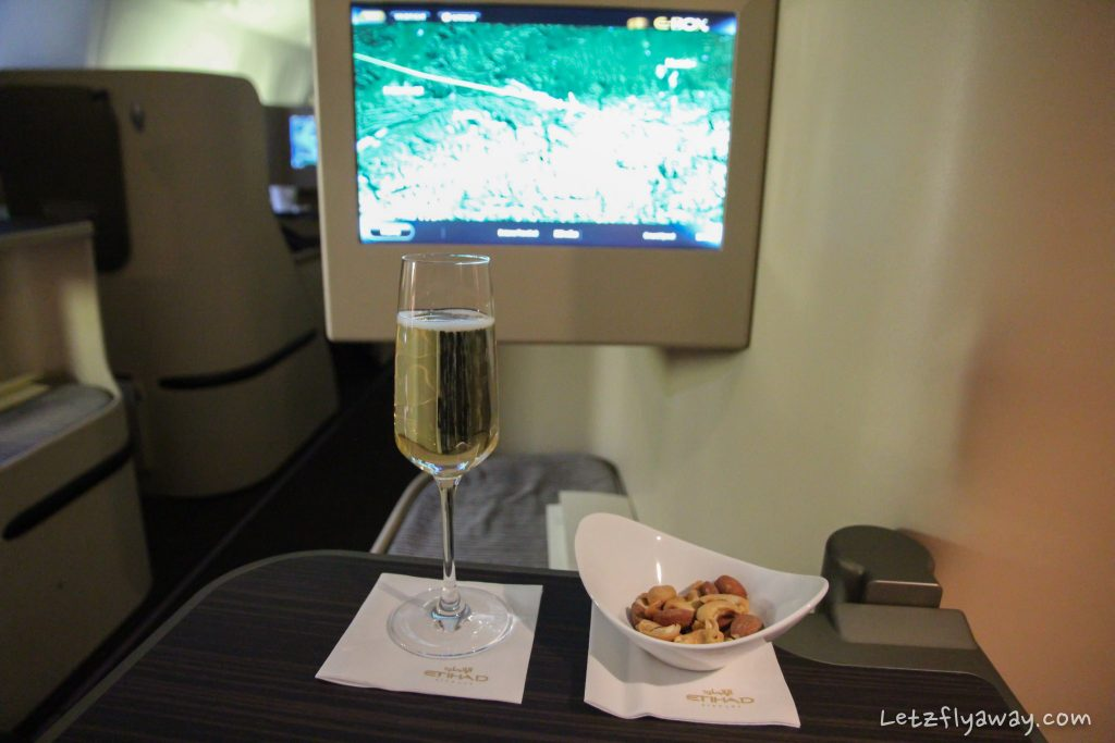 etihad business class boeing 777 champagne service