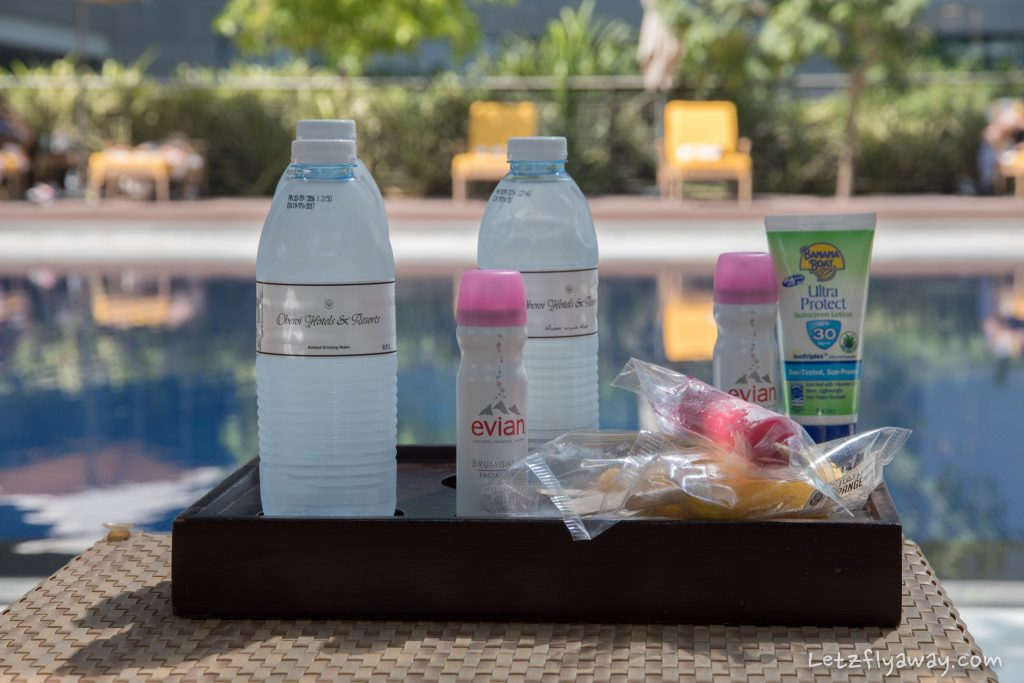 The Oberoi Dubai pool amenities with sunscreen, water, Evian facial spray and icy fruit bars