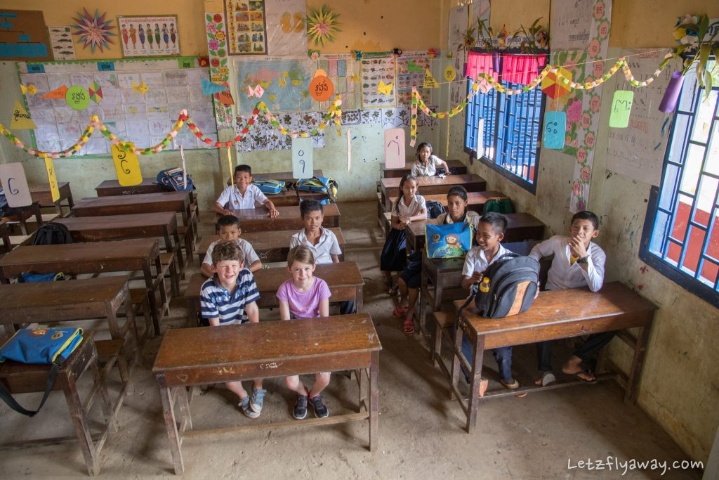 western kids visiting a school in the floating village of kampong phluk