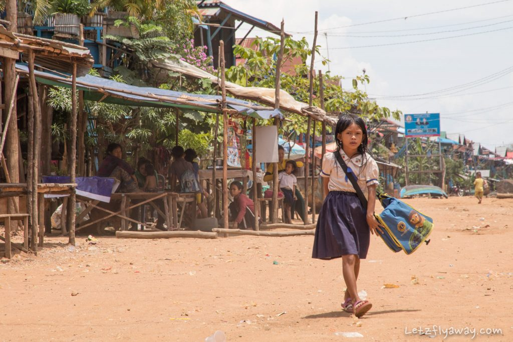 Cambodian girl going to school in the floating village