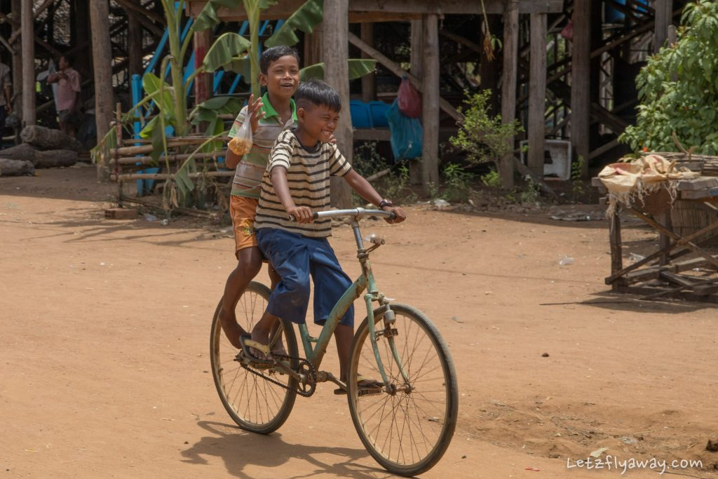 boys on a bike in kampong phluk