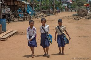 Cambodian kids going to school in the floating village